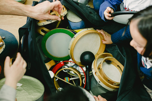 A selection of percussion being used in a children's music lesson