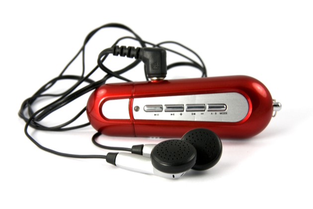 Photograph of a red MP3 player from the early '00s with headphones.