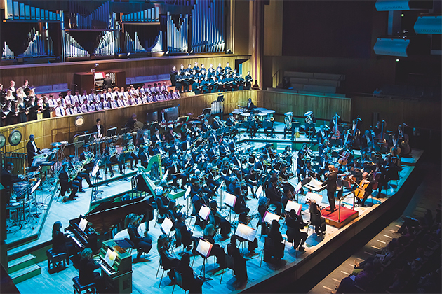 The Philharmonia Orchestra performing to a crowd