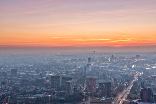Photograph of Manchester city in the sunset