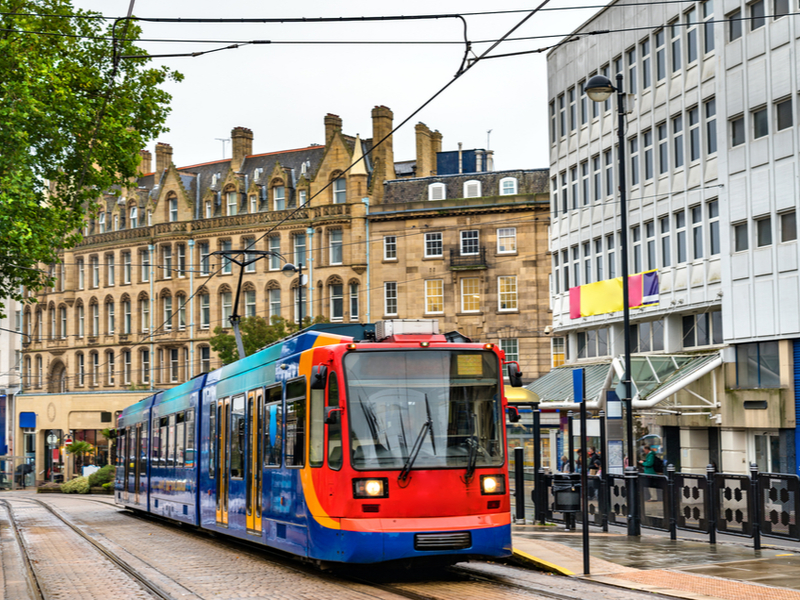 Trams running through Sheffield city centre.