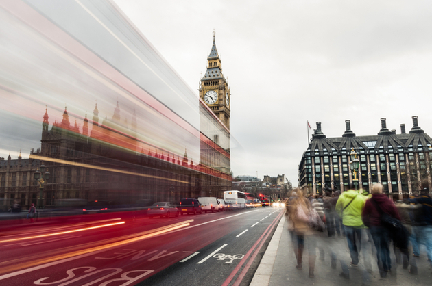 Photograph of Big Ben from across Westminister bridge, traffic is rushing past leaving blurred lights behind.